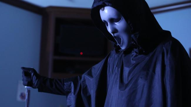 What would Scream TV be without a creepy guy in a mask with a knife?