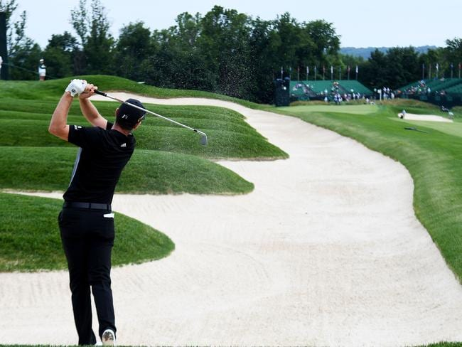 Justin Rose watches a shot.