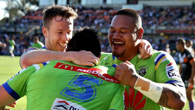 Jordan Rapana celebrates scoring a try with Sam Williams and Joseph Leilua.