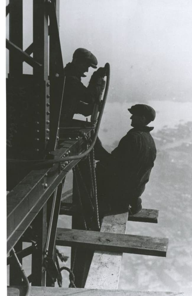 1931: Workers dangle off beams atop the Empire State Building. Picture: New York Public Library/Lewis Hine