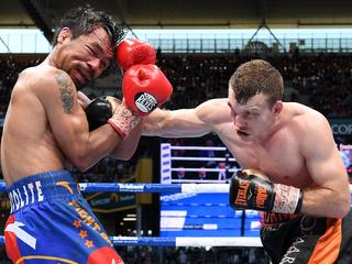 Jeff Horn of Australia (right) strikes Manny Pacquiao of the Phillipines during the WBO World Welterweight Title fight at Suncorp Stadium in Brisbane, Sunday, July 2, 2017. (AAP Image/Dave Hunt) NO ARCHIVING, EDITORIAL USE ONLY