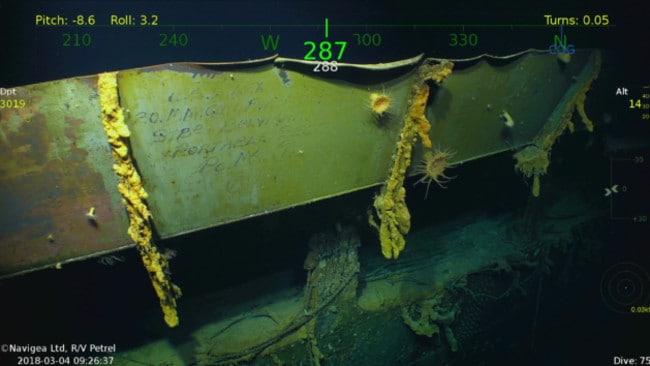 A plate of steel with writing intact among the wreckage of the USS Lexington. Picture: Vulcan