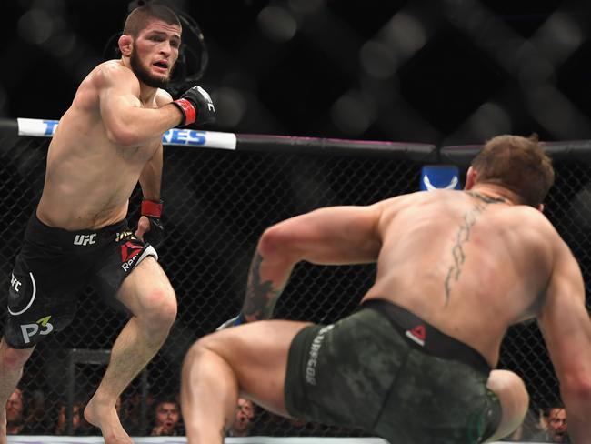 Khabib Nurmagomedov chases down a fallen Conor McGregor.