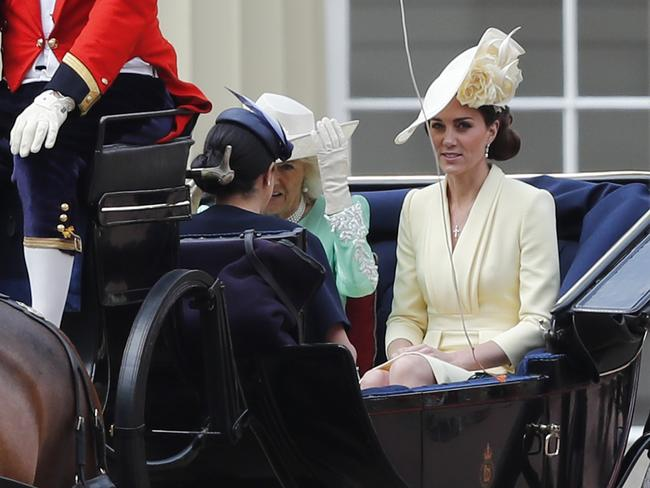 The Duchess of Cambridge appeared tense during the carriage ride, says a body language expert. Picture: AP