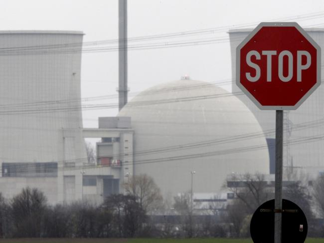 A traffic sign stands next to the nuclear power plant of Biblis, Germany. Germany has agreed to abandon nuclear energy for good. Picture: Michael Probst/AP
