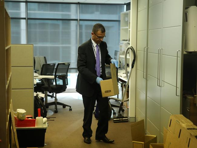 NSW detective at the Human Group Projects offices in North Sydney last year investigating fraud allegations.
