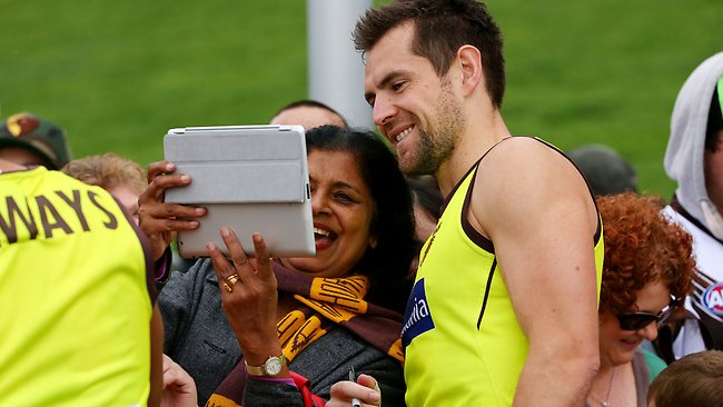 Popular ... Luke Hodge poses for a picture with a fan.