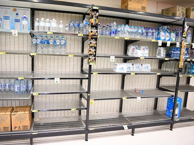 Near empty supermarket shelves are seen as Townsville residents prepare for Cyclone Debbie. Picture: Ian Hitchcock/Getty Images