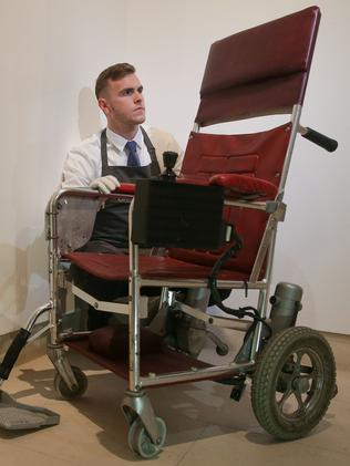 A Christie's gallery assistant poses with the motorised wheelchair. Picture: Daniel Leal-Olivas/AFP