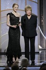 Emma Stone and Shirley MacLaine speak onstage during the 75th Annual Golden Globe Awards at The Beverly Hilton Hotel on January 7, 2018 in Beverly Hills, California. Picture: Getty