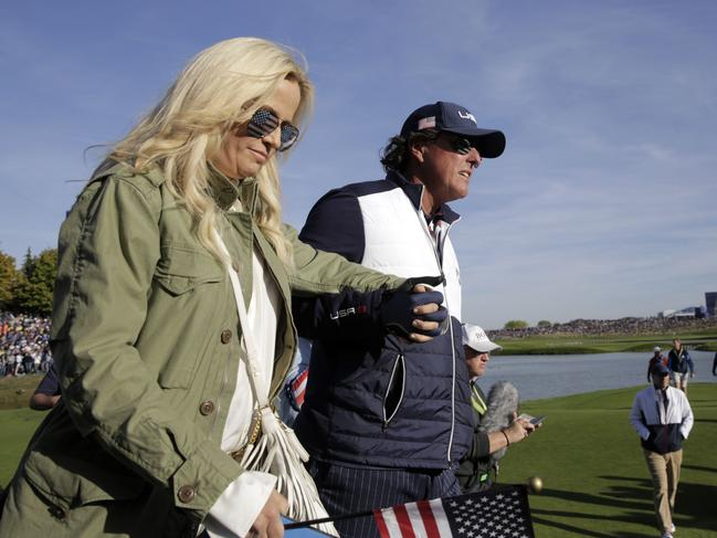 US golfer Phil Mickelson (R) walks with his wife Amy on the second day of the 42nd Ryder Cup. Picture: AFP