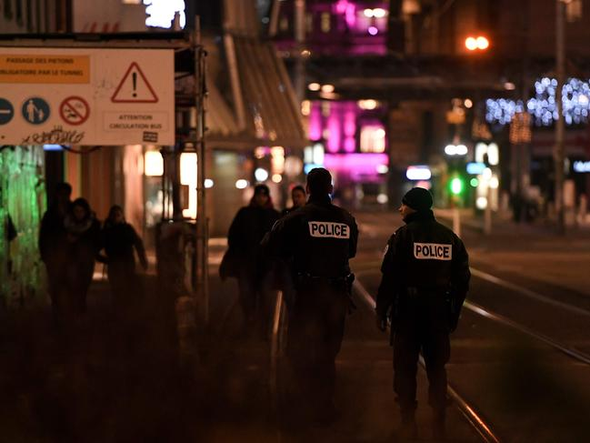 Policemen walk in the streets of Strasbourg, eastern France, after a shooting. Picture: Frederick Florin/AFP