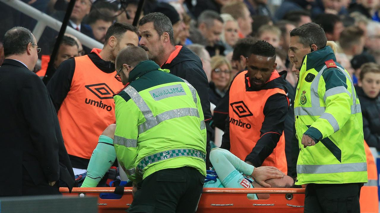 Bournemouth's English defender Adam Smith is stretchered off the pitch