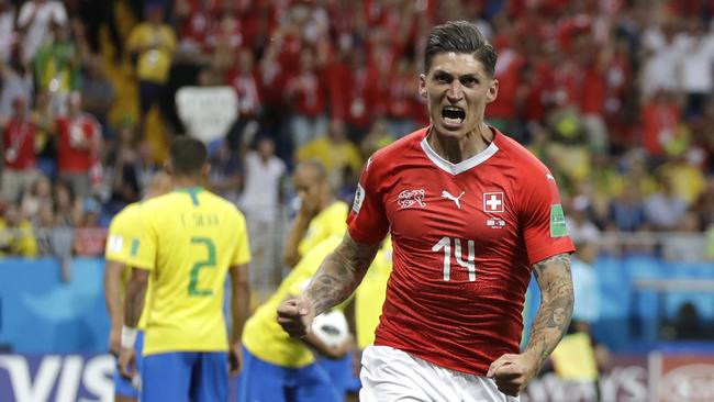 1ef8a021f Switzerland s Steven Zuber celebrates after scoring his side s opening goal