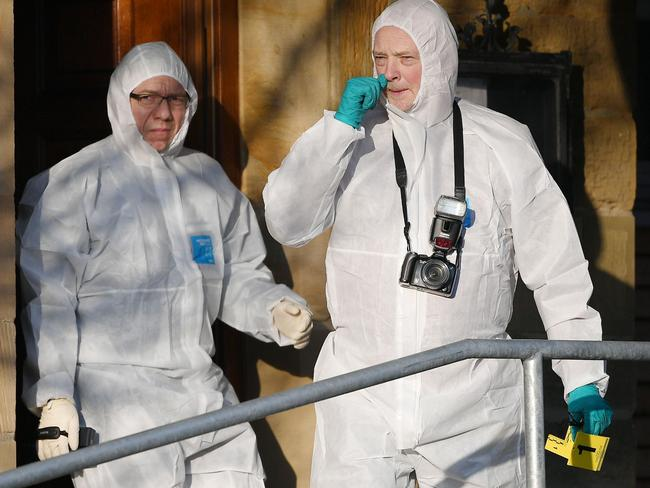 German forensic policemen work near a house where a shooter, believed to have a personal motive, launched an assault. Picture: AFP