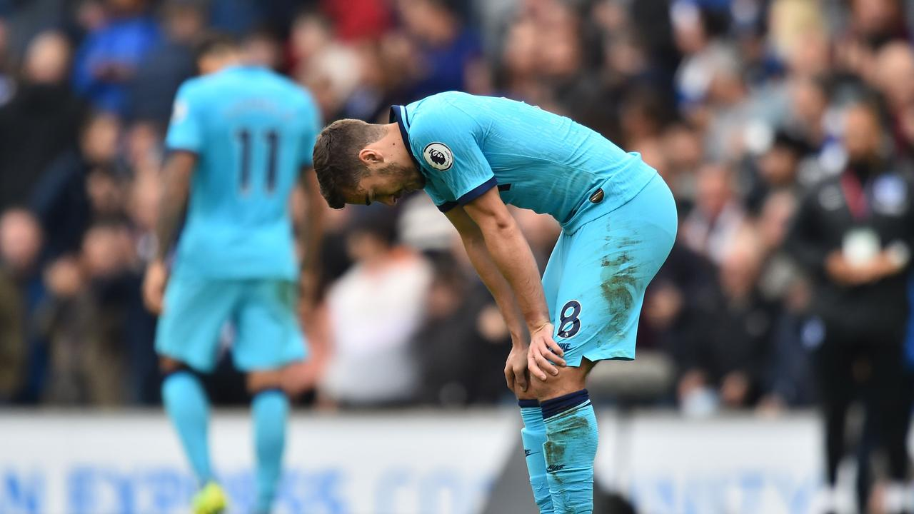 Harry Winks was dejected during the 3-0 defeat to Brighton.
