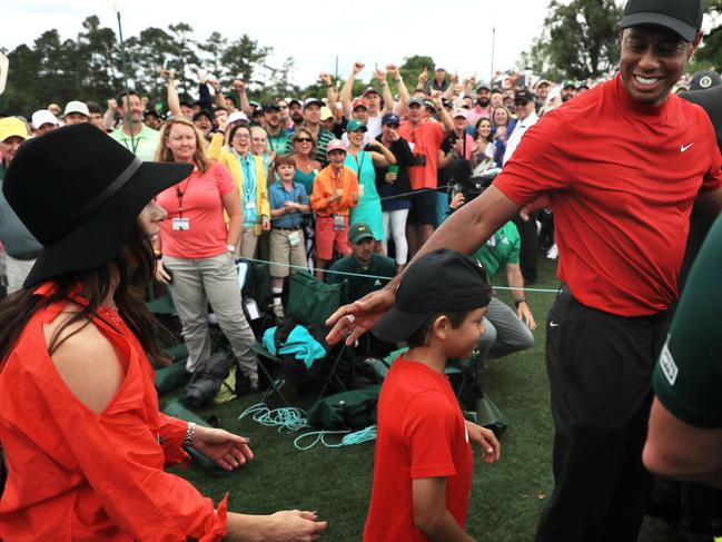 Tiger Woods (R) celebrates with his girlfriend Erica Herman (L) and son Charlie Axel (C) on April 14, 2019. Picture: Mike Ehrmann/Getty Images/AFP