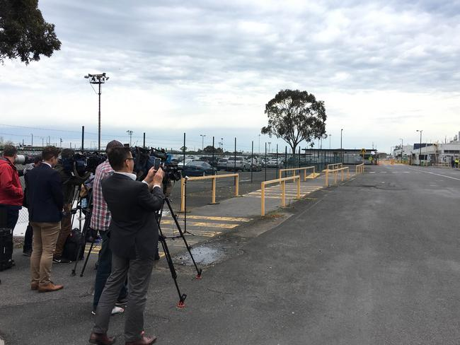 Ford has pushed the media covering the Broadmeadows factory closure well away from the gates as they wait for workers to exit. Picture: Joshua Dowling/News Corp Australia