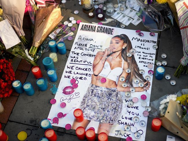 Tributes left in St Ann's Square for the people who died in the attack. Picture: Getty
