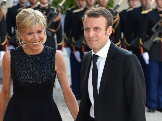 Brigitte Trogneux steps out with Emmanuel Macron in 2015 for a dinner with the King of Spain. Photo: Getty