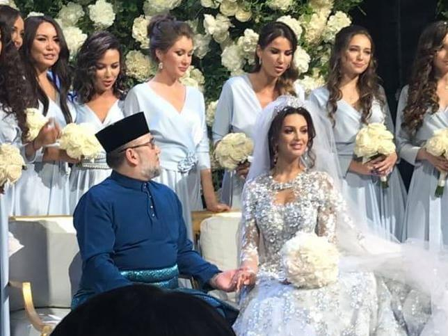Malaysia's King Sultan Muhammad V marrying Oksana Voevodina, 25, in secret in November 2018. Picture: Twitter/Nursafhia1