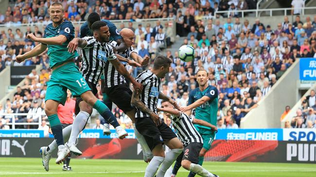 Tottenham Hotspur's English defender Eric Dier (L) heads the ball towards goal for Tottenham Hotspur's Belgian defender Jan Vertonghen (unseen) to score the opening goal during the English Premier League football match between Newcastle United and Tottenham Hotspur at St James' Park. Picture: AFP