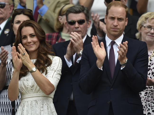 Britain's Prince William and Kate, Duchess of Cambridge, applaud Andy Murray from the Royal Box.