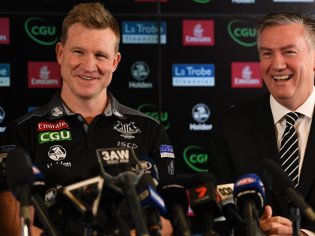 Collingwood coach Nathan Buckley (left) and club president Eddie McGuire are seen at a media conference at the Holden Centre in Melbourne, Monday, August 28, 2017. Collingwood has the announced the club has reappointed Buckley as senior coach for two years. (AAP Image/Julian Smith) NO ARCHIVING