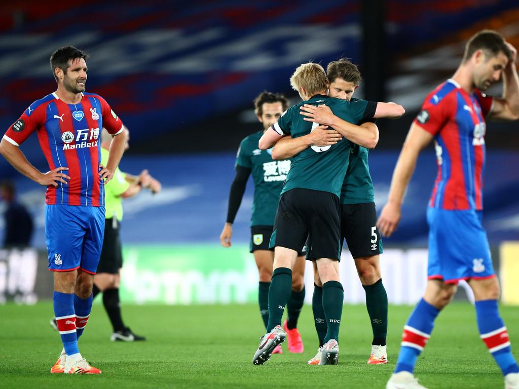 James Tarkowski Burnley hugs Ben Mee after as Scott Dann of Crystal Palace reacts after the match.
