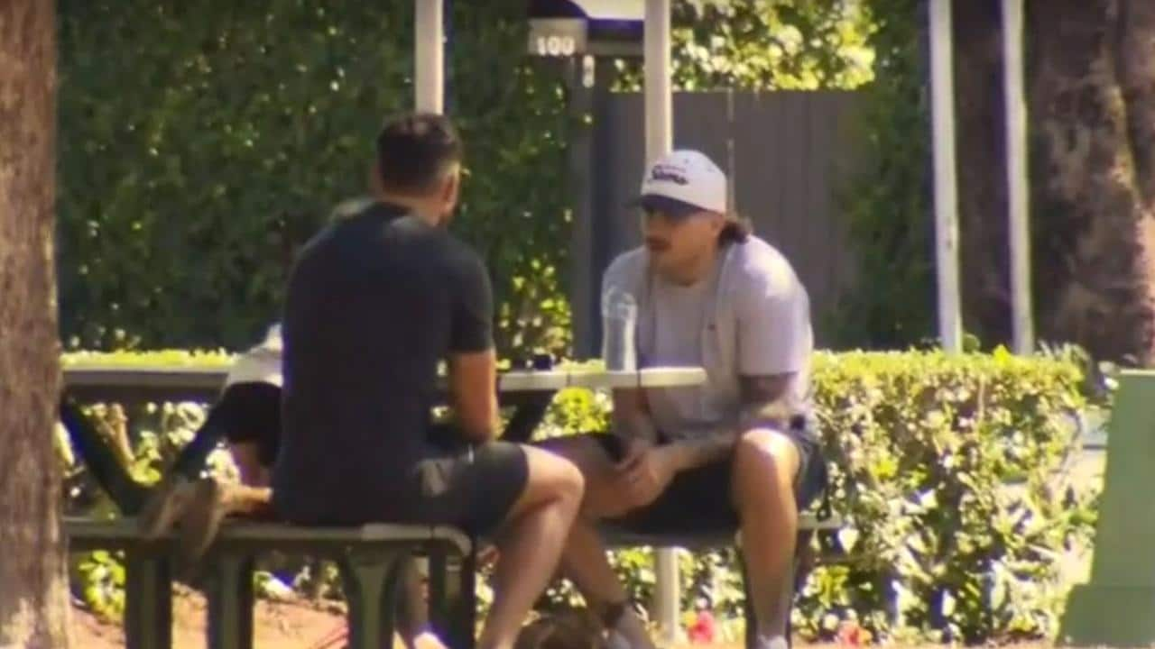 Brisbane Bronco players Darius Boyd and jack Bird seen having lunch and a chat in New Farm Park in Brisbane today, screen grabs from Channel 9 vision
