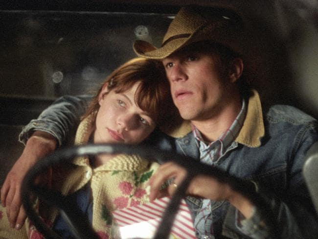In love ... Michelle Williams and Heath Ledger in a scene from the film Brokeback Mountain.