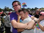 People celebrate after watching the same sex marriage vote result announcement at a picnic held by the Equality Campaign at Prince Regent Park, Surry Hills. Picture: AAP / David Moir