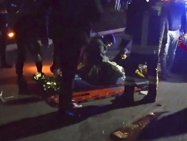 Injured people outside a nightclub in Corinaldo, central Italy. Picture: AP