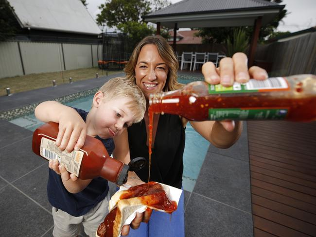 Michelle and Elliot Willmot, 2, still love tomato sauce on their sausage sandwiches but don't mind switching it up as well. Picture: AAP/Josh Woning