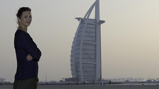 Angela Higgins on the beach in Dubai with the famous Burj Al Arab in the background. Picture: Neville Hopwood