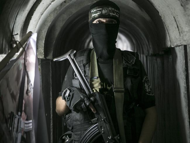 A Palestinian Hamas soldier poses in a tunnel during a weapons exhibition held at an Hamas-run youth summer camp in Gaza City in July 2016. Picture: Ibrahim Khatib