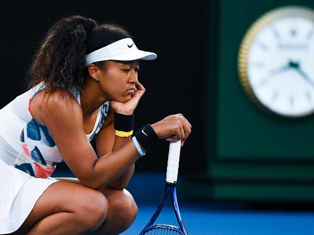 TOPSHOT - Japan's Naomi Osaka reacts after a point against Coco Gauff of the US during their women's singles match on day five of the Australian Open tennis tournament in Melbourne on January 24, 2020. (Photo by William WEST / AFP) / IMAGE RESTRICTED TO EDITORIAL USE - STRICTLY NO COMMERCIAL USE