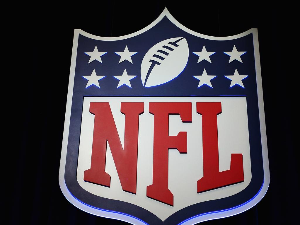 (FILES) This file photo taken on January 31, 2017 shows the NFL shield logo seen following a press conference held by NFL Commissioner Roger Goodell (not pictured) at the George R. Brown Convention Center in Houston, Texas.    The National Football League is mulling a crackdown on foul play that would see ejections for players who aim hits at an opponent's head, officials said on March 22, 2017. NFL Executive Vice President for Football Operations Troy Vincent said on Twitter the league was studying the move as part of an effort to eradicate head shots.  / AFP PHOTO / GETTY IMAGES NORTH AMERICA / Tim Bradbury