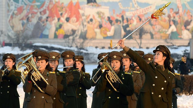 Female members of a North Korean military band perform in celebration of the country's rocket launch in Pyongyang, North Korea Wednesday, Dec. 12, 2012. North Korea successfully fired a long-range rocket on Wednesday, defying international warnings as the regime of Kim Jong Un took a big step forward in its quest to develop a nuclear missile. (AP Photo/Kyodo News) JAPAN OUT, MANDATORY CREDIT, NO LICENSING IN CHINA, FRANCE, HONG KONG, JAPAN AND SOUTH KOREA