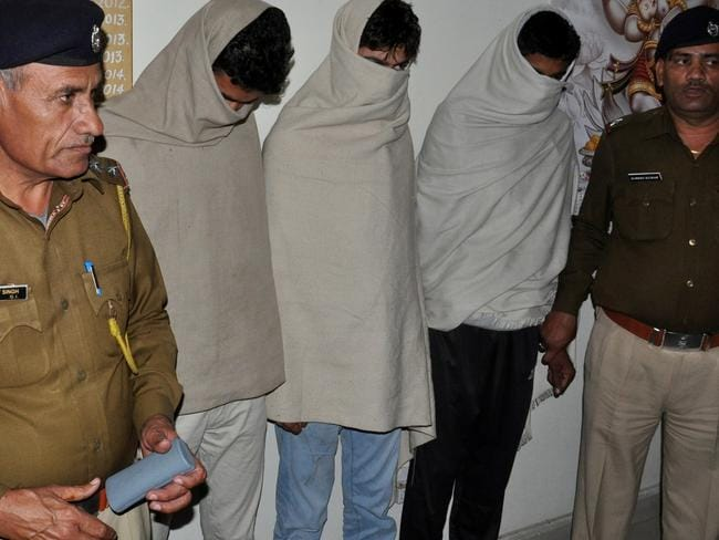 Indian residents who are alleged to have harassed the sisters are held in police custody. Picture: AFP