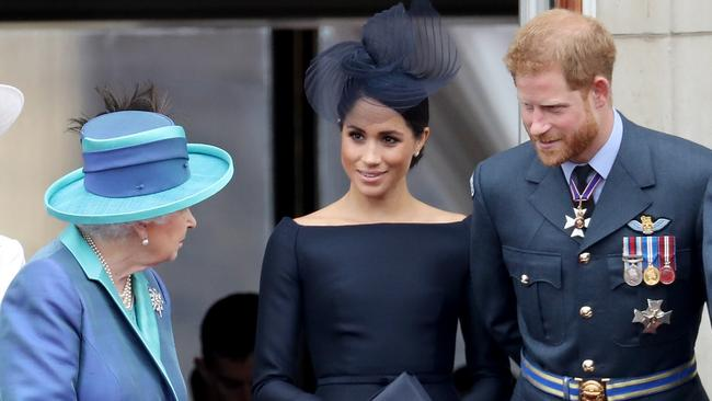 Queen Elizabeth II, Meghan, Duchess of Sussex and Prince Harry, Duke of Sussex watch the RAF fly-past on the balcony of Buckingham Palace in 2018. Picture: Chris Jackson/Getty Images