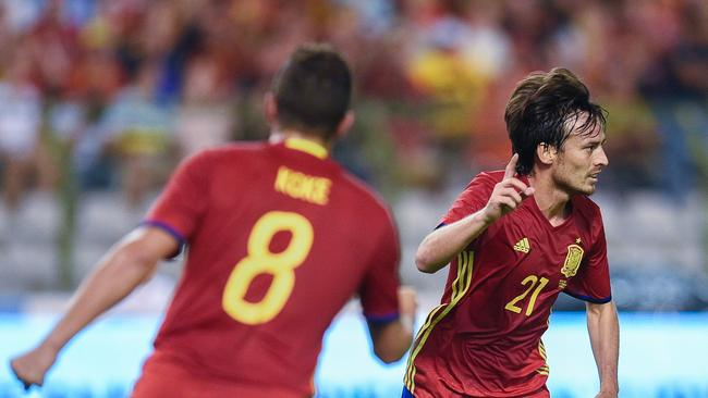 Spain's David Silva celebrates with teammates after scoring a goal against Belgium in 2016.
