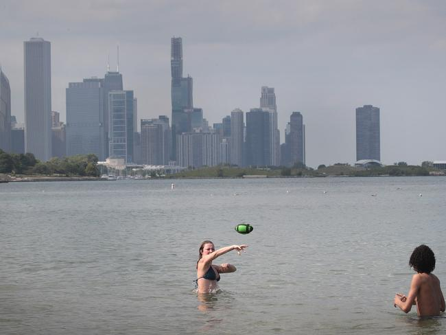 People cool off at a beach in Chicago, Illinois as temperatures climb into the high 30s with a heat index expected to reach as high as 44 degrees. Picture: Scott Olson/Getty Images/AFP