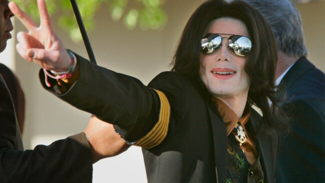 Michael Jackson gestures to fans as he enters court in 2005. Originally, eight women and four men were selected to serve as the jury for Jackson's child molestation trial. Eventually the court announced an alternative set of eight alternate jurors consisting of four men and four women. (Photo by Kimberly White/Corbis via Getty Images)