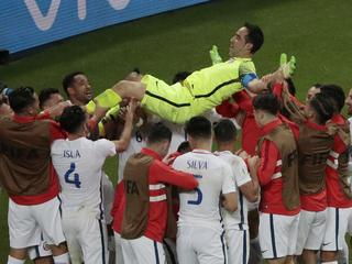 Chile goalkeeper Claudio Bravo is thrown in the air after winning the Confederations Cup, semifinal soccer match between Portugal and Chile, at the Kazan Arena, Russia, Wednesday, June 28, 2017. (AP Photo/Dmitri Lovetsky)