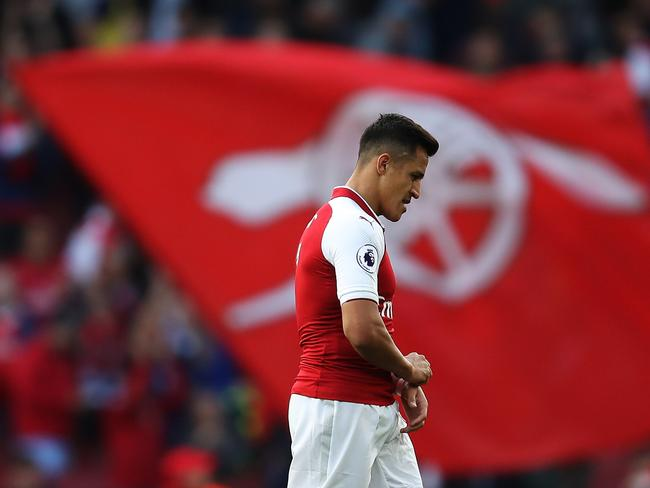 Alexis Sanchez of Arsenal walks off