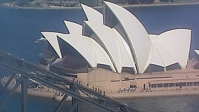 Prince Harry leads a group on the Sydney Harbour Bridge climb. Picture: Seven News