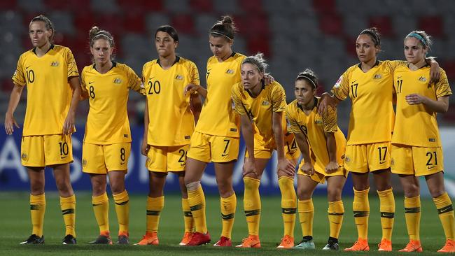 Australia players look on anxiously during the shootout.