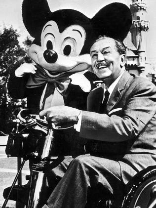 Disney with his company's most famous creation, Mickey Mouse.