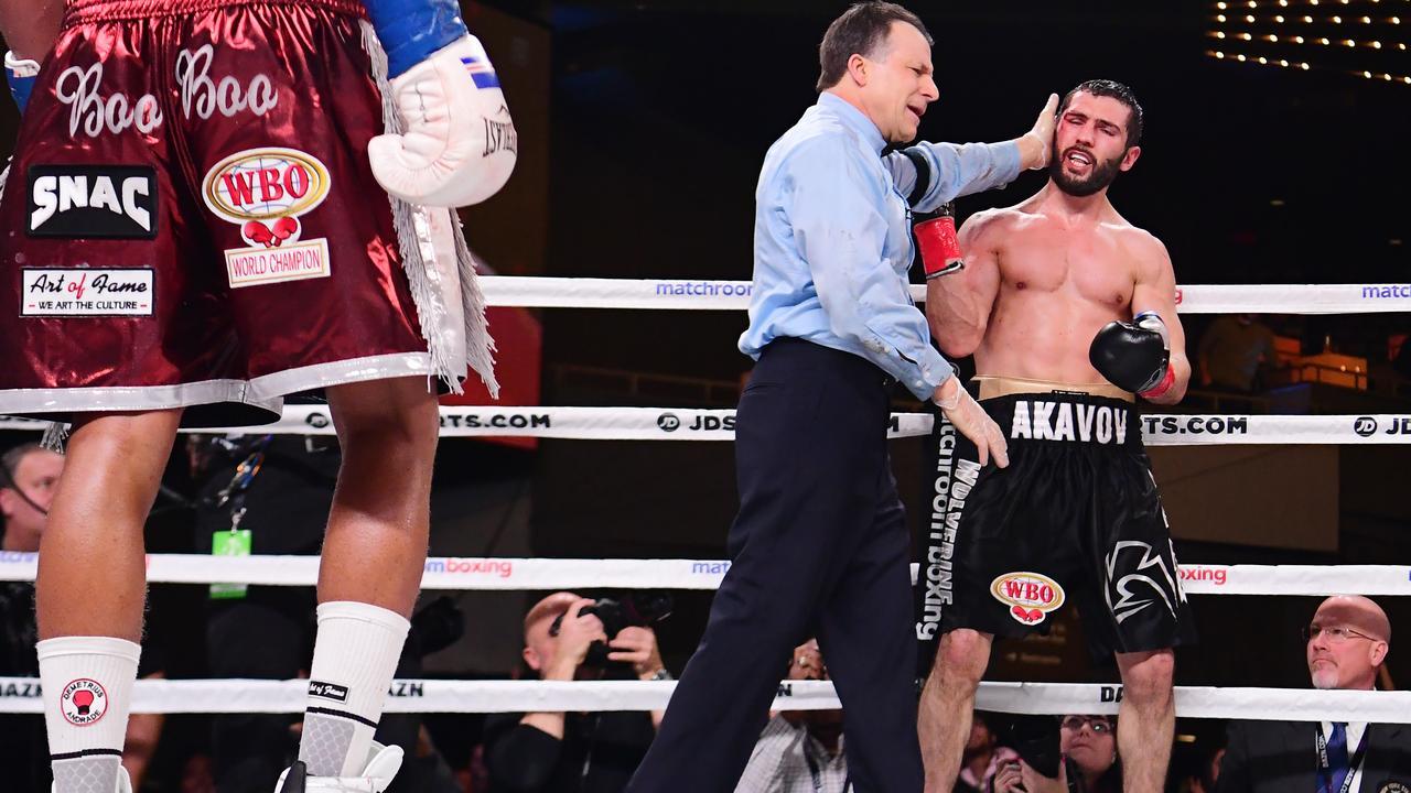 Andrade stops Akavov controversially.